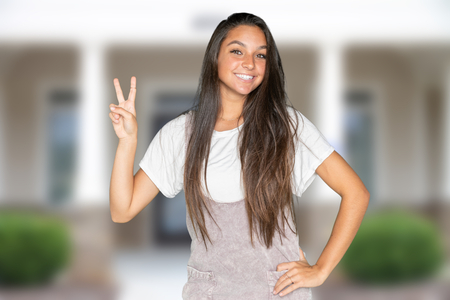 Happy teen student going to their high school Stock Photo