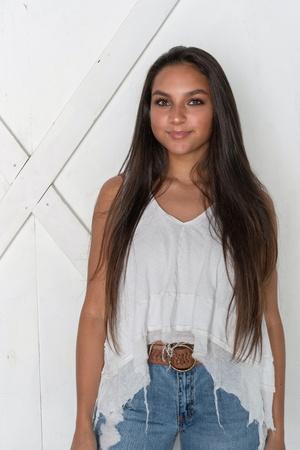 Happy smiling minority teen model posing in the studio