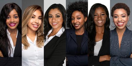 Group of six happy minority businesswomen at work Фото со стока