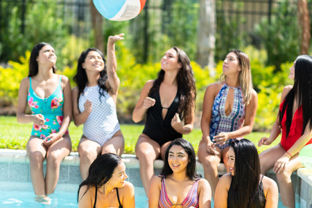 Group of friends at a summer pool party