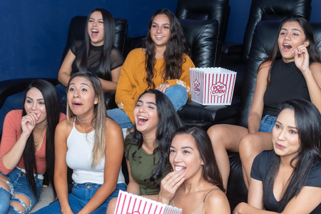 Group of friends watching movies in a home theater Stock Photo