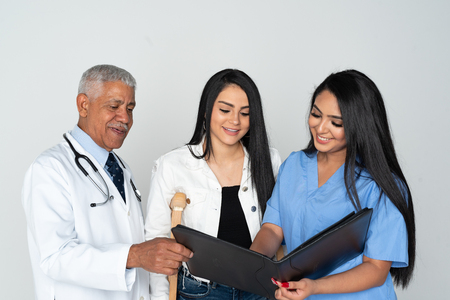 Doctor and nurse at the hospital with a patient 写真素材