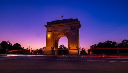 Arc de Triumf in Bucharest Romania at the sunset hour