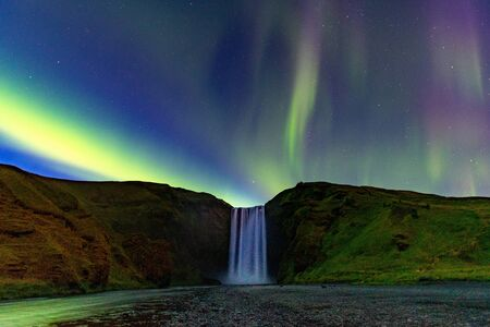 Northern Lights Aurora In Iceland set in the Skogafoss Waterfall