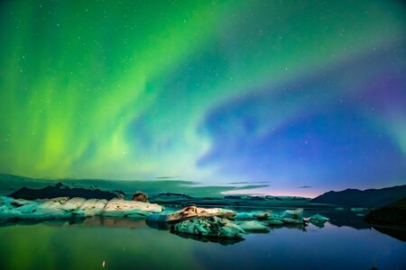 Northern Lights Aurora In Iceland set in the Glacier Lagoon Stock Photo