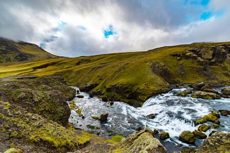 Waterfall along the Fimmvörðuháls hiking trail in Iceland during the summer