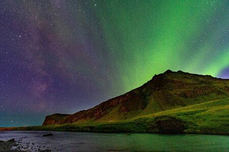 Northern Lights Aurora In Iceland along with the Milky Way