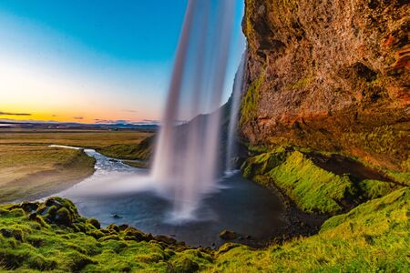 Sunset view of Seljalandsfoss waterfall in Iceland during the summer