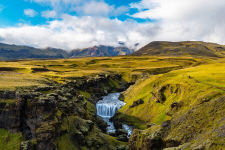 Waterfall along the Fimmvörðuháls hiking trail in Iceland during the summer Banco de Imagens