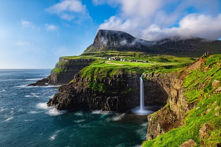 The Mulafossure waterfall on a sunny day in the Faroe Islands Banco de Imagens
