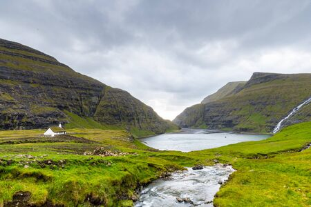 Summer view of the fishing village of Saksun in the Faroes Islands