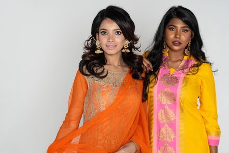 A group of two Indian women dressed in colorful native dress