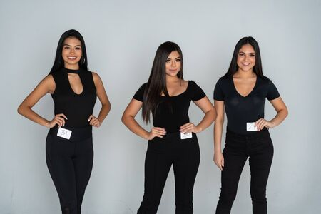 3 female models at an audition or casting for a runway model