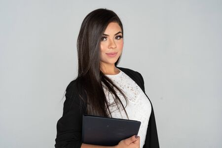 Hispanic businesswoman at an office ready for work