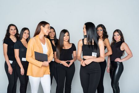 Group of hispanic teen models training to compete in a beauty pageant