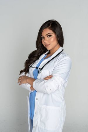 Female doctor or nurse working at her job in the hospital Banco de Imagens