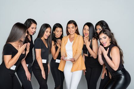 Group of young hispanic girls training for a beauty pageant