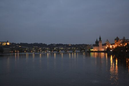 Picture of the Vltava river from the South of the Charles Bridge at night photo
