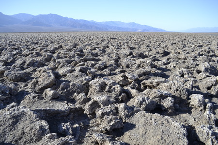 Devils golf court is formed by salt formation remaining of a salty see that got dried up many millennia ago