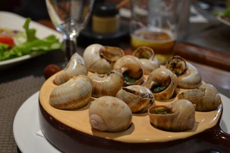typical: Typical French dish: snails Stock Photo