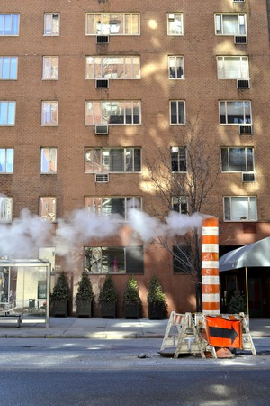 characteristic: One of the classical views of Manhattans streets. The high pressure steam produced by the steam plants and travelling underground is released when a repairmen is required using these characteristic stacks