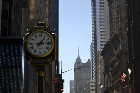 5th: Clock in 5th avenue with the Empire State Building on the background