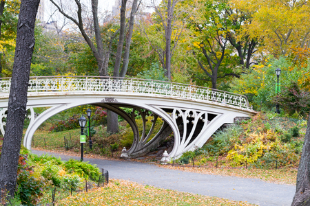 cast iron red: The gothic bridge in the West side of the reservoir in Central Park Stock Photo