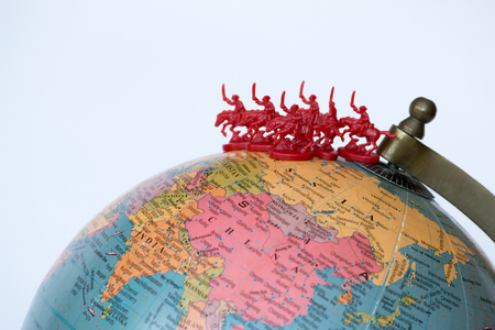mongols: Plastic soldiers on top of a globe Stock Photo