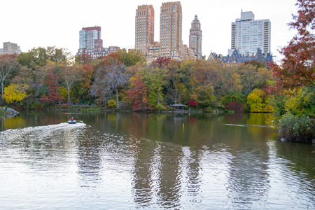 Views of one of the most iconic buildings of the Upper West Side (Dakota) from The Lake