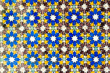 Azulejos are a decorative tin-glazed piece of ceramics used in Spain and Portugal to design mosaics Editorial