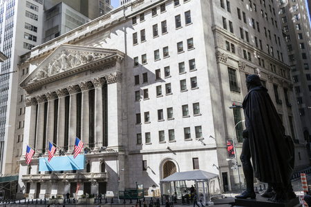 New York Stock Exchange from behind president George Washington statue in Wall street, Manhattan Stock Photo