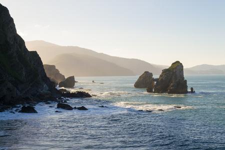 Views of the coastline from San Juan de Gaztelugatxe while climbing the stairway Stock Photo