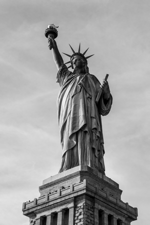 Statue of liberty  (dedicated on October 28, 1886) is one of the most famous icons of the USA Stock Photo