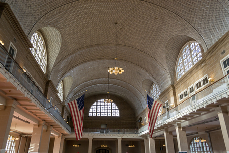 Registry room at Ellis island immigration center between 1900 and 1024 processed 5,000 immigrates per day