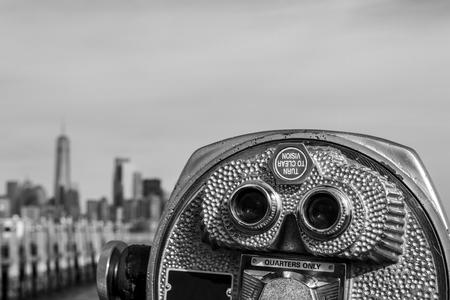 Binoculars in Liberty Island pointing towards Manhattan