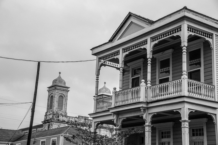 Classic shotgun house in New Orleans with the  Marigny Opera house in the background Editorial