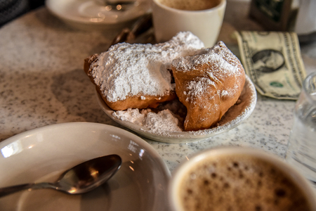 Beignet and coffee for breakfast in New Orleans