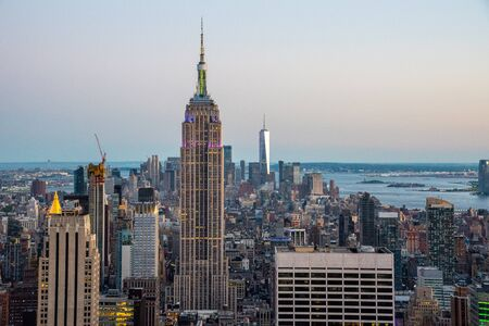 NYCs lower Manhattan with the Empire State Building from a high up point in Midtown during 2019 gay pride Banque d'images - 128749569