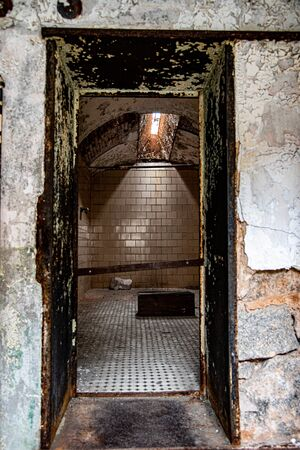 Cell in an abandoned penitentiary in severe disrepair