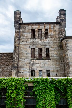Facade of a penitentiary with the windows and bars connecting to the cells