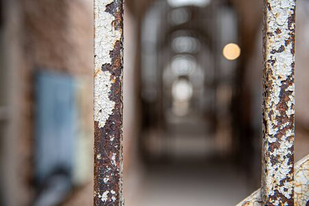 Rusty prison bars in an abandoned penitentiary