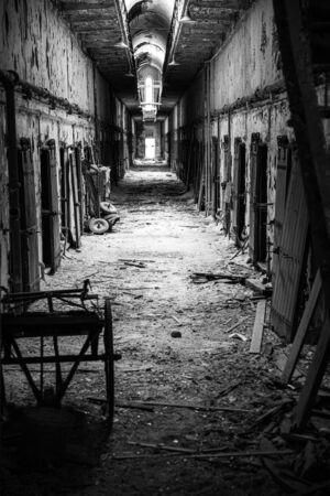 Corridor in an abandoned penitentiary in severe disrepair
