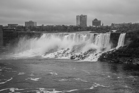 Panoramic views of Niagara falls from the Canadian side on a cloudy day