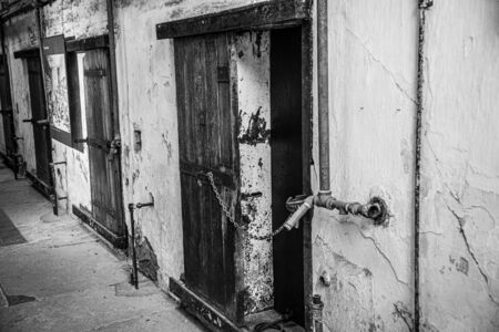 Gate to enter a cell in an abandoned jail in disrepair