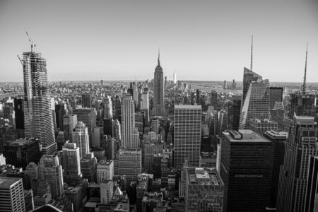 NYCs lower Manhattan with the Empire State Building from a high up point in Midtown Reklamní fotografie