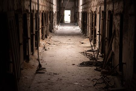Corridor in an abandoned penitentiary in severe disrepair
