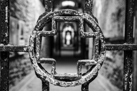 Entrance to an infirmary in an abandoned penitentiary in disrepair Stock Photo