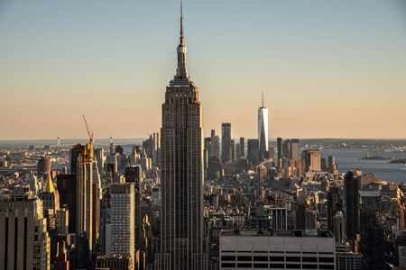 NYCs lower Manhattan with the Empire State Building from a high up point in Midtown Stock Photo
