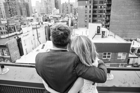 Newly married couple holding each other in a roof top in the Upper East side of Manhattan (NYC, USA)