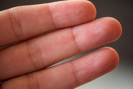 Macro photograph of three fingers from close